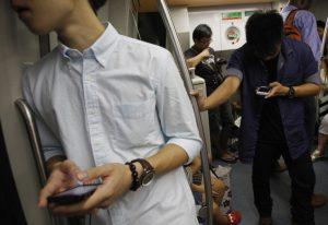 Man using phone on train